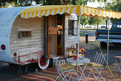 Vintage trailer set up at campsite